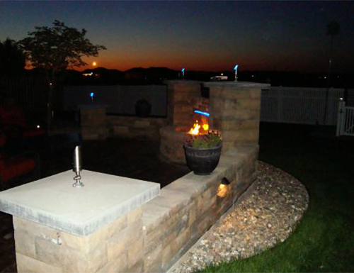 Beautiful backyard firepit at night.