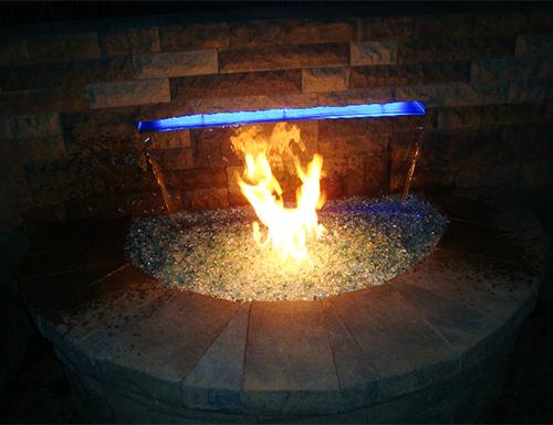 Closeup of contemporary backyard firepit.