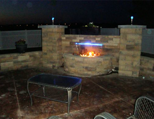 Contemporary firepit at night.