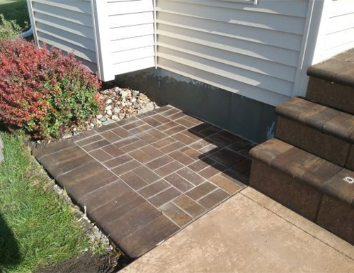 Small extension of patio pavers.