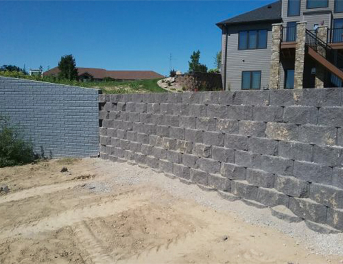 Large grey retaining wall.
