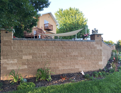 Retaining wall for patio home