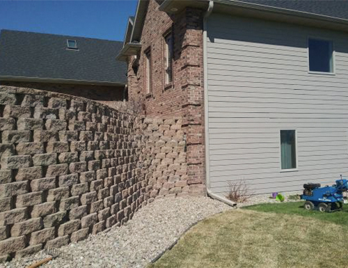 Finished tall residential retaining wall.