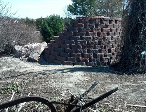 Backside of commercial waterfall using a retaining wall.