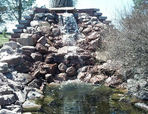Closeup of commercial waterfall landscaping.